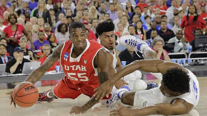 Utah's Delon Wright (55) and Duke's Justise Winslow (12) go after a loose ball during the second half of a college basketball regional semifinal game in the NCAA Tournament Friday, March 27, 2015, in Houston. (AP Photo/David J. Phillip)