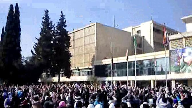 In this Wednesday, Feb. 22, 2012 citizen journalism image provided by the Local Coordination Committees in Syria and accessed on Thursday, Feb. 23, 2012,  Syrian student protesters chant slogans, during a demonstration against Syrian President Bashar Assad, at the Aleppo University's Square, in the northern city of Aleppo, Syria.  President Bashar Assad's regime escalated attacks on rebel bases elsewhere, with helicopter gunships strafing areas in the northwest, activists said. (AP Photo/Local Coordination Committees in Syria) THE ASSOCIATED PRESS IS UNABLE TO INDEPENDENTLY VERIFY THE AUTHENTICITY, CONTENT, LOCATION OR DATE OF THIS HANDOUT PHOTO