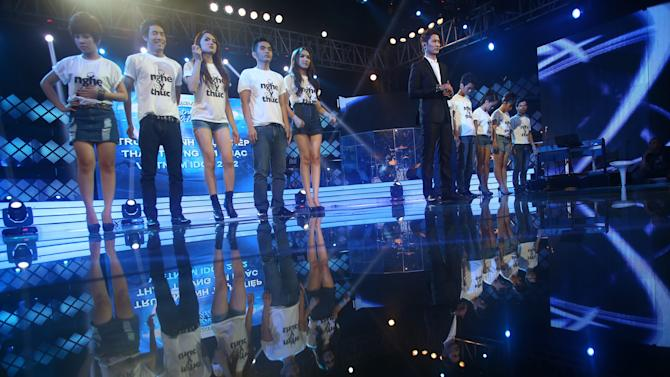 """In this photo taken Friday, Oct. 12, 2012, contestants, wearing T-shirts with a slogan """"Listen responsibly"""" for a campaign against online piracy, stand on stage at a """"Vietnam Idol 2012"""" in Ho Chi Minh City, Vietnam. The campaign is aimed at Zing.vn and other copyright violated websites. Zing.vn, one of globe's top 550 most visited websites, is a wildly popular website laden with unlicensed songs and Hollywood movies, a prime exhibit of the digital piracy that is strangling the music industry in Asia and eroding legitimate online sales around the world. (AP Photo/Na Son Nguyen)"""