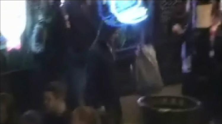 This image made from surveillance video provided by the FBI shows a man identified by the FBI as Sami Samir Hassoun placing an item into a trash receptacle. A federal judge raised the specter of the Boston Marathon Thursday as he sentenced a young Lebanese immigrant to 23 years in prison for placing a backpack he believed contained a powerful bomb along a bustling city street near the Chicago Cubs' baseball stadium. (AP Photo/FBI)