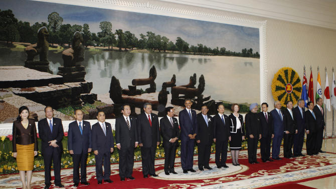 U.S. President Barack Obama, eighth from left, smiles as he stands with other leaders for a group photo at the East Asia Summit in Phnom Penh, Cambodia, Tuesday, Nov. 20, 2012. They are, from left, Thailand's Prime Minister Yingluck Shinawatra, Philippines' President Benigno Aquino III, Myanmar's President Thein Sein, Laos' Prime Minister Thongsing Thammavong, Japan's Prime Minister Yoshihino Noda, Indonesia's President Susilo Bambang Yudhoyono, Brunei's Sultan Hassanal Bolkiah, Obama, Cambodia's Prime Minister Hun Sen, China's Premier Wen Jiabao, Australia's Prime Minister Julia Gillard, India's Prime Minister Manmohan Singh, South Korea's President Lee Myung-bak, Malaysia's Prime Minister Najib Razak, New Zealand's Prime Minister John Key, Singapore's Prime Minister Lee Hsien Loong, Vietnam's Prime Minister Nguyen Tan Dung and Russia's Foreign Minister Sergei Lavrov. (AP Photo/Vincent Thian)