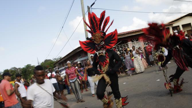 A man dressed up as the devil performs during the Congos and Devils celebration in Nombre de Dios