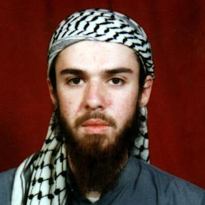 FILE - This undated file photo obtained from a religious school where he studied for five months in Bannu, near Islamabad, Pakistan, shows American-born Taliban fighter John Walker Lindh, an inmate at the federal prison in Terre Haute, Ind. The warden of the prison holding high-risk inmates including Lindh insisted Thursday, June 27, 2013, that he was obeying a court order to allow daily group prayer by permitting inmates to pray in pairs within their cells. The warden told a federal judge that when the prison allowed group prayer earlier this year, Muslim inmates formed gangs and bullied other prisoners. (AP Photo/File)