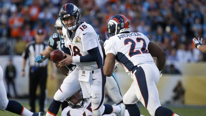 Denver Broncos' quarterback Manning hands off to Anderson during the first quarter of the NFL's Super Bowl 50 against the Carolina Panthers in Santa Clara