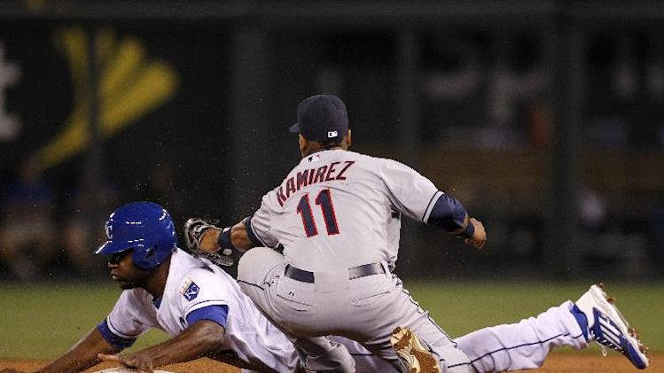 Kansas City Royals' Lorenzo Cain steals second base as Cleveland Indians second baseman Jose Ramirez (11) is late with the tag in the 14th inning of a baseball game at Kauffman Stadium in Kansas City, Mo., Thursday, July 24, 2014. (AP Photo/Colin E. Braley)