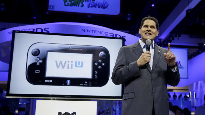 Reggie Fils-Aime, President and chief operating officer of Nintendo of America, addresses the media at the Nintendo Wii U software showcase during the E3 game show in Los Angeles, Tuesday, June 11, 2013. (AP Photo/Jae C. Hong)