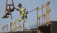 A construction worker directs a steel hoist at the foundation of a new condo complex in Sunrise, Fla., Thursday, Jan. 5, 2012. A burst of hiring in December pushed the unemployment rate to its lowest level in nearly three years, giving the economy a boost at the end of 2011. (AP Photo/J Pat Carter)