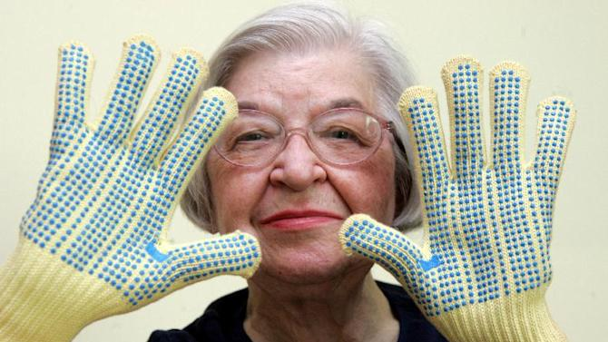 FILE - Stephanie Kwolek, 83, shown in this June 20, 2007 file photo taken in Brandywine Hundred, Del., she wears regular house gloves made with the Kevlar she invented. Her friend, Rita Vasta, told The Associated Press that Stephanie Kwolek died Wednesday in a Wilmington hospital. at age 90. (AP Photo/The News Journal, Jennifer Corbett)