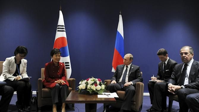 Russia's President Putin meets with South Korea's President Park Geun-hye on the sidelines of the World Climate Change Conference 2015 (COP21) at Le Bourget, near Paris