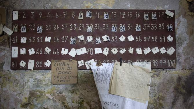 Numbers referring to pedicab owners are displayed at a private pedicab garage in downtown Havana