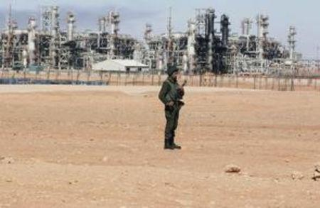An Algerian soldier stands near the Tiguentourine Gas Plant in In Amenas