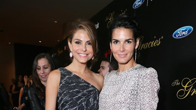 Maria Menounos, left, and Angie Harmon arrive at Sexy Hair Celebrates The Gracies Presented By The Alliance For Women In Media Foundation, on Tuesday, May, 21, 2013 in Beverly Hills, Calif. (Photo by Alexandra Wyman/Invision for Sexy Hair/AP Images)