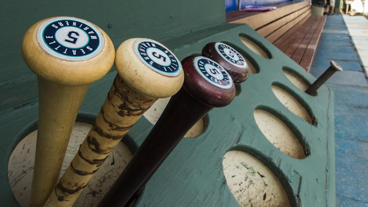 Seattle Mariners' Brad Miller bats sit in the dugout prior to the first inning of a baseball game against the Philadelphia Phillies, Wednesday, Aug. 20, 2014, in Philadelphia. (AP Photo/Chris Szagola)