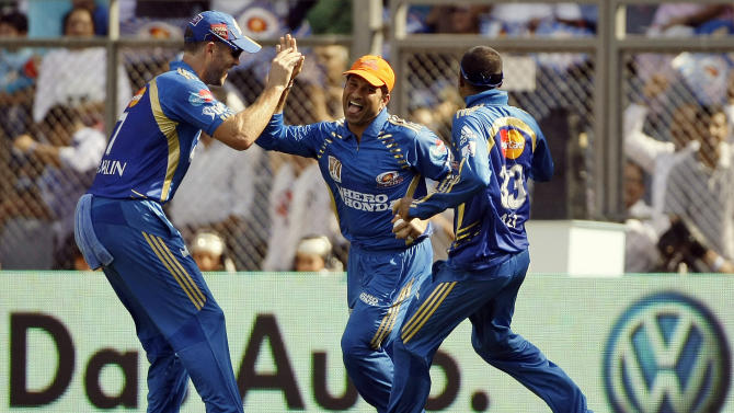 Mumbai Indian's Sachin Tendulkar, center, celebrates with his teammates the wicket of Pune Warriors batsman Jesse Ryder, unseen, during their Indian Premier League (IPL) cricket match in Mumbai, India, Wednesday, April 20, 2011. (AP Photo/Rajanish Kakade)