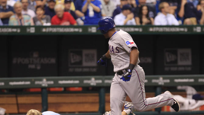 Texas Rangers Adrian Beltre gestures towards a TBS camera man after he fell following Beltre around the bases after hitting a second inning home run against the Tampa Bay Rays, during Game 4 of baseball's American League division series Tuesday, Oct. 4, 2011, in St. Petersburg, Fla. (AP Photo/Chris O'Meara)