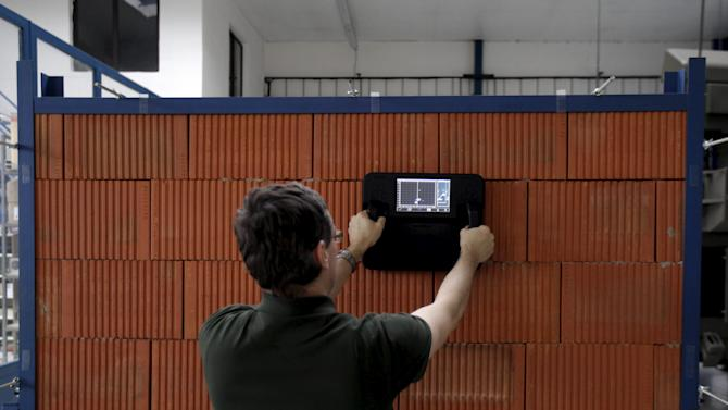 A worker tests a newly developed through-wall radar Retwis at a plant in Pardubice