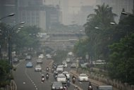 File photo shows haze hanging over a busy road in Jakarta. On the eve of the summit, the world&#39;s science academies warned that Earth faced a dangerous double whammy posed by voracious consumption and a population explosion