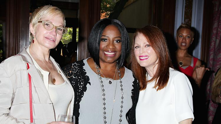 """This May 27, 2014 photo released by Starpix shows actors Ellen Barkin, left, LaTanya Richardson Jackson, center, and Julianne Moore, at an afternoon tea hosted by Moore and honoring Jackson for her 2014 Tony Award nomination for best actress in a play for her role in """"A Raisin in the Sun,"""" at Lady Mendl's Tea Salon in New York. (AP Photo/Starpix, Dave Allocca)"""