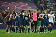 US women's soccer coach Pia Sundhage celebrates with the players after her team won Olympic gold. Sundhage insists her team's Olympic final victory over Japan is only the start of a golden era for the Americans which will peak with success at the 2015 World Cup