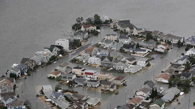 This photo made available by the New Jersey Governor's Office shows flooding on the bay side of Seaside, N.J. on Tuesday, Oct. 30, 2012 after superstorm Sandy made landfall in New Jersey Monday evening. (AP Photo/New Jersey Governor's Office, Tim Larsen)
