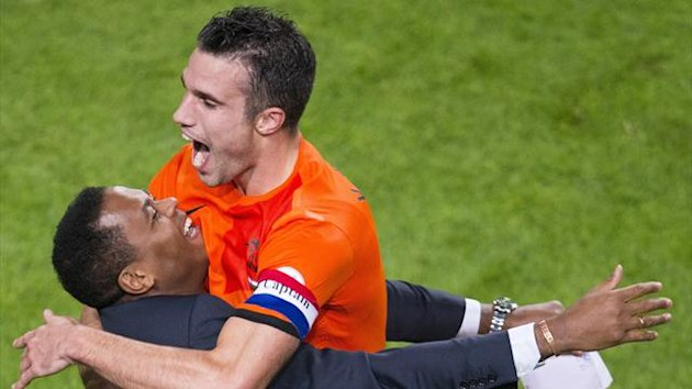 Robin van Persie celebrates his record breaking goal with Netherlands' assistant coach Patrick Kluivert (AFP)