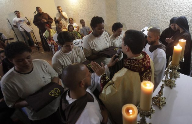 "Members of Franciscan fraternity, O Caminho, receive their habits upon reaching the level of ""aspirant"", during a mass at at the group's house in Rio de Janeiro"