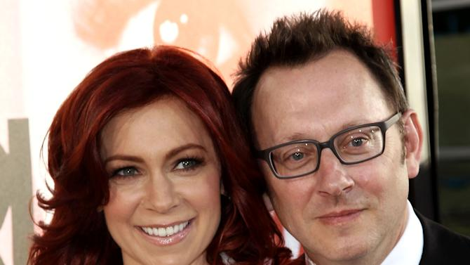 """FILE - This May 30, 2012 file photo shows married actors Carrie Preston, left, and Michael Emerson at the premiere of HBO's """"True Blood"""" in Los Angeles.  Emerson has played a serial killer, a mysterious, villainous Island leader and currently stars as a billionaire computer genius on """"Person of Interest."""" But he says playing the romantic interest for his real life wife has been his most unsettling role. Emerson plays the off-beat Harold Finch in """"Person of Interest,"""" which airs Thursdays at 10 p.m. Eastern. His wife Carrie Preston has a recurring role as Finch's former fiance, who believes he is dead. (Photo by Matt Sayles/Invision/AP, file)"""