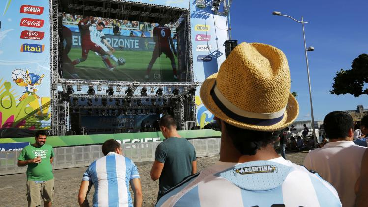 Fans watch a replay of the goal by Argentina's Lionel Messi against Iran at the FIFA fan fest in Recife