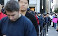 <p>Customers wait in line to purchase the Apple iPhone 5 outside the Apple Fifth Avenue flagship store in New York City. Apple fans queued in Asia, Europe and North America Friday for the new iPhone 5, which appeared set to break sales records despite lukewarm reviews and complaints about its mapping system.</p>
