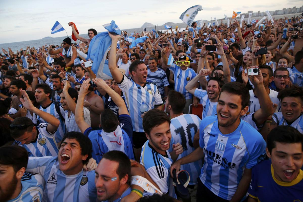 Argentina soccer fans react as they watch a broadcast of the 2014 World Cup semi-final