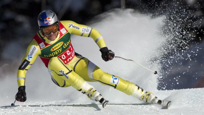 Aksel Lund Svindal, of Norway, speeds down the hill during the men's  super-G ski race at the Lake Louise Winterstart World Cup in Lake Louise, Alberta, Sunday, Nov. 25, 2012. (AP photo/The Canadian Press, Jonathan Hayward)