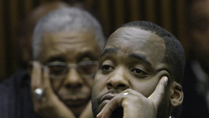 "FILE - In this Oct. 28, 2008 file photo, former Detroit Mayor Kwame Kilpatrick, right, looks on as his father Bernard, left, watches at his sentencing hearing in Detroit. Businessman Karl Kado, who held contracts at Detroit's convention center, said Monday, Dec. 3, 2012 that he was a ""hostage"" who felt compelled to pay thousands of dollars to then-Mayor Kwame Kilpatrick and his father or lose work. Kado told jurors that he personally delivered $5,000 to $10,000 to Kilpatrick ""three or four times."" He said he also delivered money through a top mayoral aide and separately paid $200,000 to $300,000 to Kilpatrick's father, Bernard. Kado is a crucial witness at the corruption trial, which began in September. (AP Photo/File)"