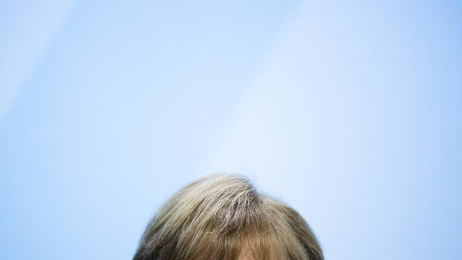 German Chancellor Angela Merkel attends a news conference after a meeting of the federal government and the German states governors about the countries' energy future at the chancellery in Berlin on Wednesday, May 23, 2012. (AP Photo/Markus Schreiber)