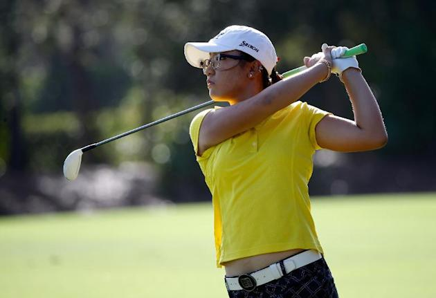 Lydia Ko of New Zealand plays a shot on the 12th hole during the second round of the CME Group Titleholders at Tiburon Golf Club on November 22, 2013 in Naples, Florida