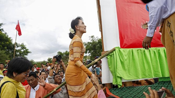 Myanmar pro-democracy leader Aung San Suu Kyi arrives to give a speech on voter education at the Hsiseng township in Shan state