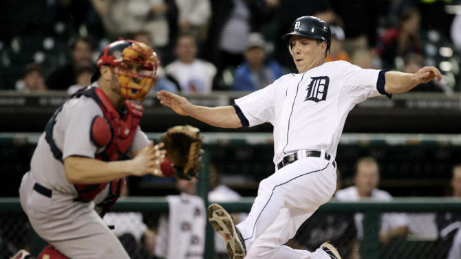 Detroit Tigers' Andy Dirks, right, scores against Boston Red Sox catcher Jason Varitek from first base on a double by Brennan Boesch in the first inning of game two of a baseball double-header Sunday, May 29, 2011 in Detroit. (AP Photo/Duane Burleson)