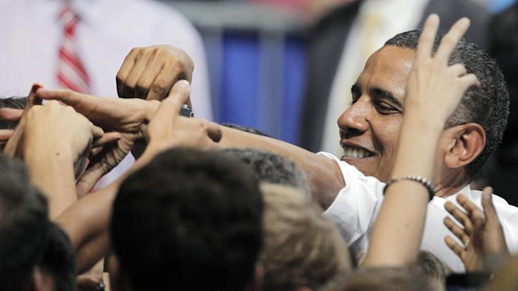President Barack Obama shakes hands with supporters during a campaign rally at the University of Colorado, in Boulder, Colo., Thursday, Nov. 1, 2012. (AP Photo/Brennan Linsley)