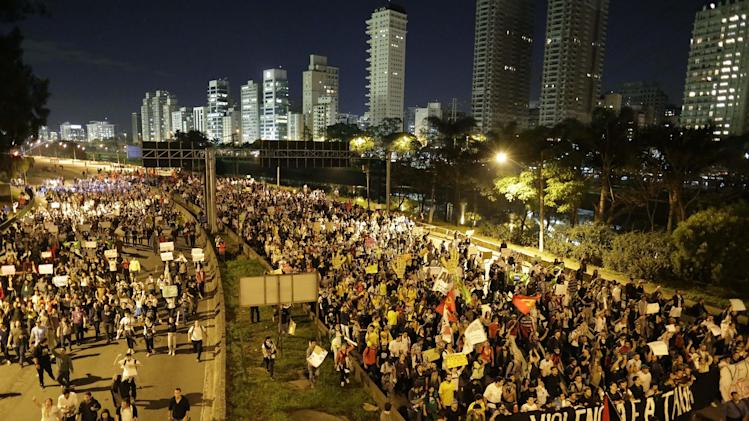 Protestors march in Sao Paulo, Brazil, Monday, June 17, 2013. Protesters massed in at least seven Brazilian cities Monday for another round of demonstrations voicing disgruntlement about life in the country, raising questions about security during big events like the current Confederations Cup and a papal visit next month. (AP Photo/Nelson Antoine)