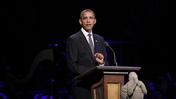 """President Barack Obama speaks at """"A Concert for Hope"""" at the Kennedy Center in Washington, Sunday, Sept. 11, 2011, on the 10th anniversary of the Sept. 11 terrorist attacks. In front of the podium is a limestone angel which broke off the National Cathedral during last month's East coast earthquake. (AP Photo/Charles Dharapak)"""