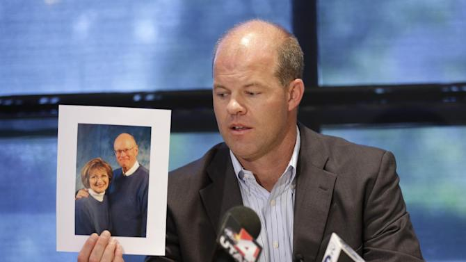 FILE - In this Aug. 14, 2014, file photo, attorney Paxton Guymon holds a photograph of Jim and Jan Harding during a news conference in Salt Lake City. Jan Harding, 67, who nearly died after unknowingly drinking iced tea mixed with chemicals has been released from a Salt Lake City hospital. Harding has been slowly improving since Aug. 10, when she drank a single sip of sweetened iced tea at Dickey's Barbecue in South Jordan, a Salt Lake City suburb. (AP Photo/Rick Bowmer, File)