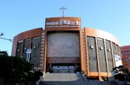 This file photo shows the facade of the Yoido Full Gospel Church in Seoul. Prosecutors have launched an investigation into the founder of South Korea's largest church, who has been accused by religious elders of embezzlement involving millions of dollars