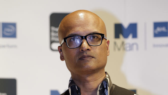 Indian author Jeet Thayil, shortlisted for the Man Booker Prize, holds a copy of his book 'Narcopolis' during a photo call at the Royal Festival Hall, in London, Monday Oct. 15, 2012. The 50,000 British pounds (US 80,000 dlrs) prize will be announce Tuesday, Oct. 16, 2012. (AP Photo/Lefteris Pitarakis)