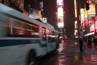 People navigate Times Square during a snow storm Wednesday, Nov. 7, 2012, in New York. Coastal residents of New York and New Jersey faced new warnings to evacuate their homes and airlines canceled hundreds of flights as a new storm arrived Wednesday, only a week after Superstorm Sandy left dozens dead and millions without power. (AP Photo/Frank Franklin II)