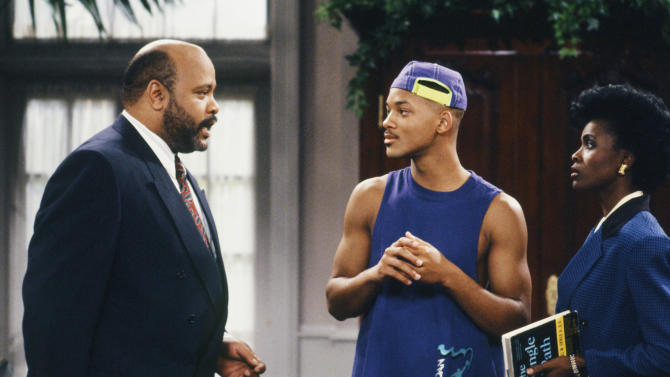 """This photo provided by NBC shows, from left, James Avery as Philip Banks, Will Smith as William """"Will"""" Smith, and Janet Hubert as Vivian Banks, in episode 7, """"Def Poet's Society"""" from the TV series, """"The Fresh Prince of Bel-Air."""" Avery, 65, the bulky character actor who laid down the law as the Honorable Philip Banks has died. Avery's publicist, Cynthia Snyder, told The Associated Press that Avery died Tuesday, Dec. 31, 2013. (AP Photo/NBC, Ron Tom)"""
