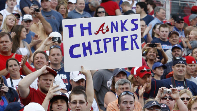 Atlanta Braves third baseman Chipper Jones walks back to the dugout after being honored by the Cincinnati Reds before a baseball game, Thursday, May 24, 2012 in Cincinnati. Jones plans to retire after this season. (AP Photo/Al Behrman)