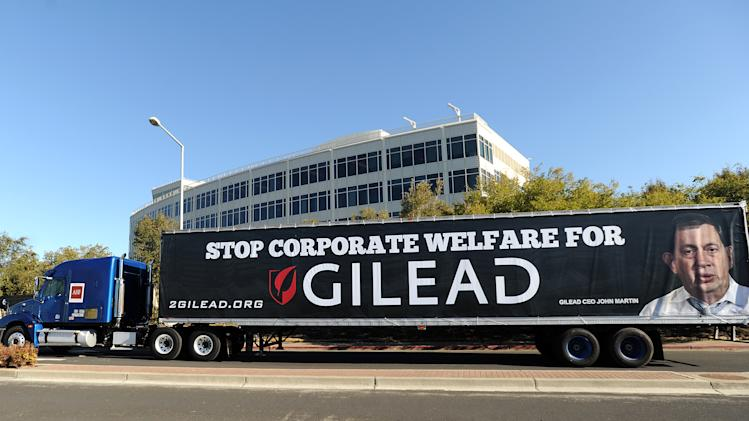 A truck circles Gilead Sciences headquarters in Foster City, Calif., on Wednesday, Nov. 14, 2012, as part of protest urging the drug maker to lower prices for its Stribild AIDS medication. About forty protesters from across the country marched through streets around the company's headquarters for about an hour. (Noah Berger /AP Images for AIDS Healthcare Foundation)