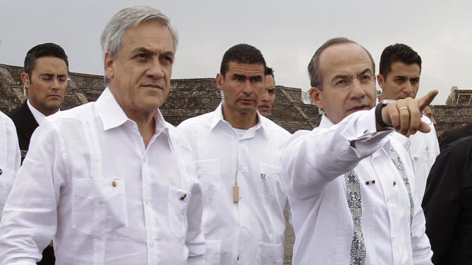 Chile's President Sebastian Pinera, left, walks with Mexico's President Felipe Calderon as they tour the Teotihuacan archeological site on the outskirts of Mexico City, Saturday July 9, 2011. Pinera is on a three-day official visit to Mexico. (AP Photo/Franklin Reyes)