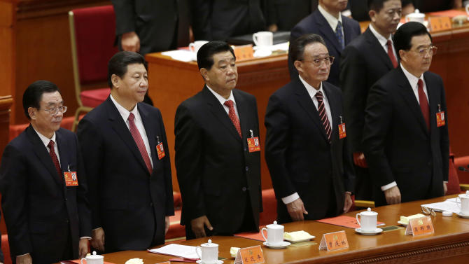 Senior party members from left, Central Commission for Discipline Inspection head He Guoqiang, Chinese Vice President Xi Jinping, People's Political Consultative Conference Chairman Jia Qinglin, National People's Congress ChairmanWu Bangguo and Chinese President Hu Jintao stand singing of the Internationale, the international communist anthem, at at the closing ceremony of the 18th Communist Party Congressheld at the Great Hall of the People in Beijing Wednesday, Nov. 14, 2012. (AP Photo/Vincent Yu)