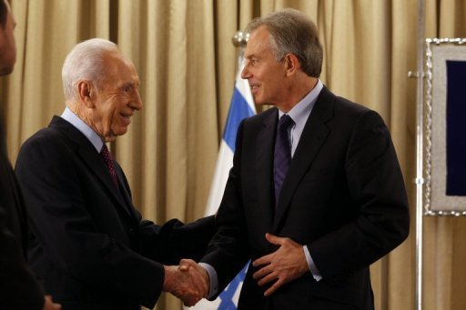 "Israeli President Shimon Peres (right) shakes hands with Tony Blair, Special Envoy of the Quartet on the Middle East, in Jerusalem on Monday. Russia on Friday said the Middle East Quartet is an ""insufficient"" format for long-term resolution of the conflict between Israel and the Palestinians, calling on the body to work together with the Arab League"