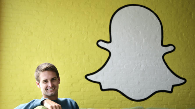 In this Thursday, Oct. 24, 2013, Snapchat CEO Evan Spiegel poses for photos, in Los Angeles. Spiegel dropped out of Stanford University in 2012, three classes shy of graduation, to move back to his father's house and work on Snapchat. Spiegel's fast-growing mobile app lets users send photos, videos and messages that disappear a few seconds after they are received (AP Photo/Jae C. Hong)